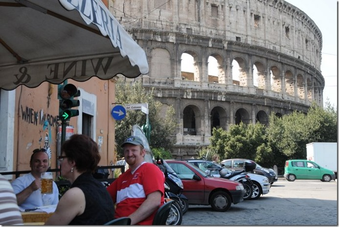 Italian in Italy with a view of the coloseum